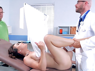Doctor plays with patient's pussy