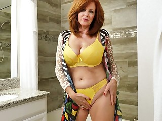 Peppery haired mature woman Andi James is handsome a shower and masturbating pussy