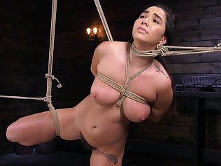 Busty Karlee Grey gets her feet spanked together with pussy abused in bondage
