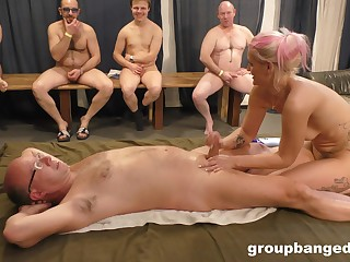 Blonde whore pleases nude men close by erotic massage