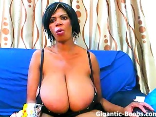 Mature ebony with gigantic tits