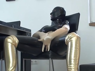 Big Tits Girl In Black Latex Catsuit + Mask + Gloves Piss In White-headed Boots