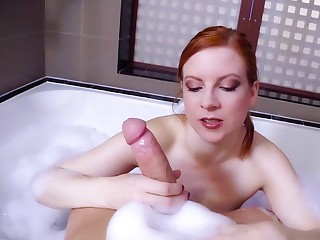 Hot redhead dazzles with her sensual POV handjob