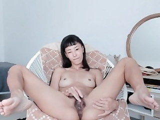 Kira Opens Beside and Plays With respect to Her Hairy Pussy