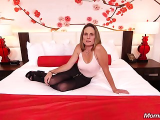 Skinny brunette milf with saggy tits, Judith, is riding a hard lifeless blarney for a camera