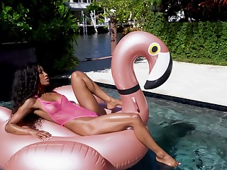 Aroused ebony shares proper dick by the pool